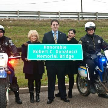 Rep. Maria Donatucci helps to dedicate the bridge named in honor of her late husband and predecessor as state Representative , the Honorable Robert C. Donatucci.