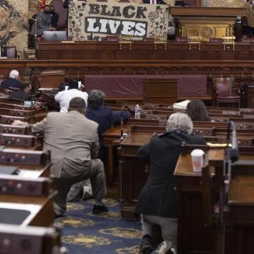 Rep. Mullery participates in a moment of silence on the house floor.