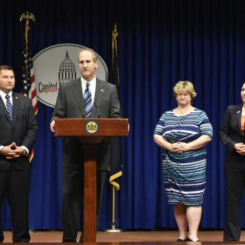 Rep. Joe Petrarca speaks at a Capitol news conference to discuss two bills that would institute cross-reporting measures for child and animal abuse.  Joining Rep. Petrarca are Sen. Guy Reschenthaler, Cathy Palm of the Center for Children's Justice of Pennsylvania, and Kristen Tullo of the Humane Society of the United States.