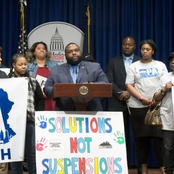Rep. Jordan Harris is joined by his colleague Rep. Jake Wheatley and supporters of proposed legislation at a Harrisburg news conference to discuss ending the practice of out-of-school suspensions for elementary school students who commit minor infractions.