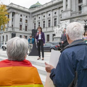 Rep. Mary Isaacson spoke at a rally in support of the LGBTQ+ community. She explained why passing non-discrimination laws ensures equality for all and is critical to the commonwealth.