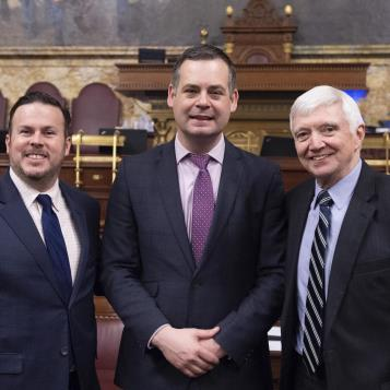 Democratic Leader Frank Dermody, right, and Rep. Kevin Boyle, left, welcome to the House Chamber the Honourable Pearse Daniel Doherty, a member of the Irish Parliament who serves as his political parties Chief Deputy and main spokesman of fiscal policy.