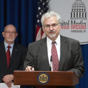 Democratic Policy Chairman Mike Sturla speaks at a news conference to discuss legislation that would amend the Public School Code to change the way cyber charter schools are funded.