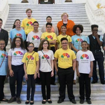 Reps. Mike Schlossberg and Pete Schweyer welcome Allentown School District students to Harrisburg, who participate in a free after-school musical program called El Sistema, which provides instruments and lessons to youth in poorer neighborhoods.