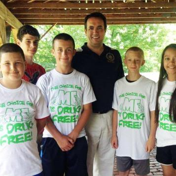 "Rep. Frank Burns meets with participants in the Patton Youth Fair and was proud to see their ""drug free"" message on display."