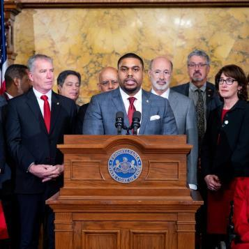 Rep. Jason Dawkins speaks at a press event after Gov. Tom Wolf announced a plan to include funding in this year's state budget to address lead and asbestos issues in public schools.