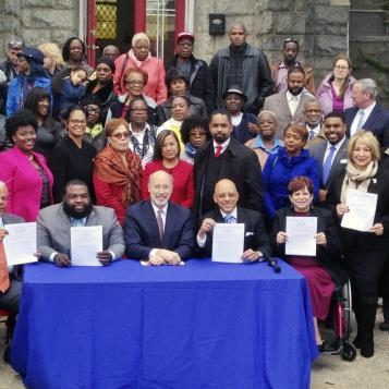 "State Reps. Jordan Harris and Maria Donatucci join Gov. Tom Wolf, members of the state Liquor Control Board, and state and local Philadelphia legislators for the signing of a bill that increases the state's ability to better deal with ""stop and go"" nuisance establishments throughout Pennsylvania."