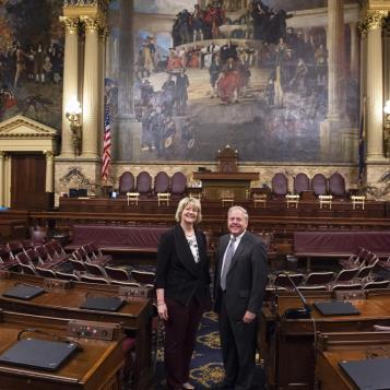 State Rep. Bob Freeman with Easton Main Street Manager Kim Kmetz in the chamber of the state House of Representatives on a recent visit to Harrisburg. (4/8/19)