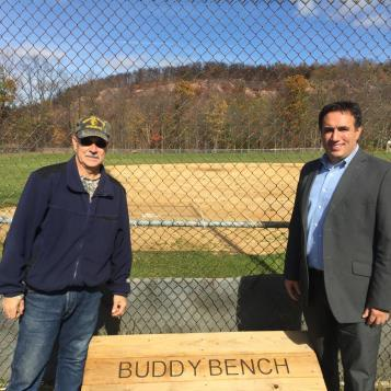 Rep. Burns donated a Buddy Bench to Benscreek Baseball Field, represented in this photo by Dennis Ratosky Sr.  Buddy Benches are places that kids can go if they are looking for a peer to play with, and Burns has been placing them at playgrounds and ball fields throughout the 72nd Legislative District.