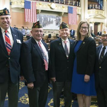 Rep. Leanne Krueger-Braneky welcomes to Harrisburg a VFW group as they recognize the 100th anniversary of the United States of America's entrance into World War I.
