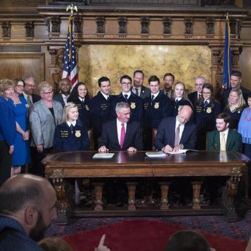 Governor Tom Wolf signs the Pa Farm, an historic bi-partisan package of legislation to assist Pennsylvania farmers.