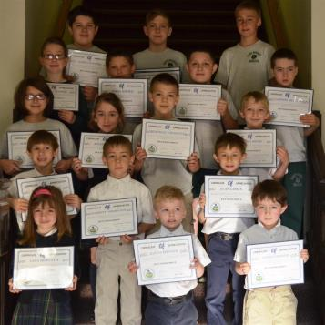 Students from Saint Benedict School receiving certificates from Rep. Frank Burns for collecting pet food items.