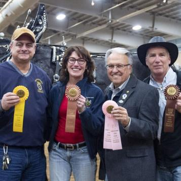 Reps. Dave Delloso, Mary Isaacson, Eddie Day Pashinski, and Ed Neilson show off their ribbons after completing the Feed Scurry event at the PA Farm Show.