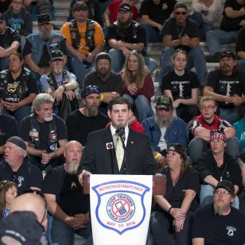 Rep. Jaret Gibbons speaks at a rally with members of the Alliance of Bikers Aimed Toward Education (ABATE) about his legislation that would stiffen penalties for distracted driving.