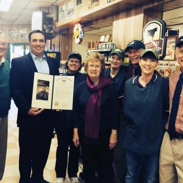 Rep. Frank Burns presents a citation to Smithmyer Superette recognizing and celebrating their 50 years of business in Loretto.