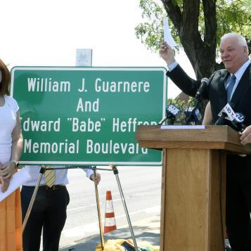 Rep. Bill Keller speaks at a dedication ceremony in Philadelphia to rename the portion of Columbus Boulevard as the William J. Guarnere and Edward 'Babe' Heffron Memorial Boulevard.  Both men, now deceased, served during WW II with Easy Company, 2nd Battalion, 506th Parachute Infantry Regiment, in the 101st Airborne Division. Their stories were chronicled in the 2001 miniseries 'Band of Brothers,' which highlighted Easy Company's missions during World War II.