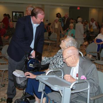 Rep. Bradford speaks with constituents at the Meadowood Centenarian Celebration in Worcester Township.