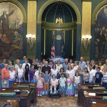 Johnstown area residents visit the state Capitol on a bus trip sponsored by Reps. Frank Burns and Gary Haluska, and Sen. Wozniak. The picture was taken in the Senate chamber.