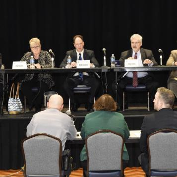 Members of the House Democratic Policy Committee discuss state police fees for municipalities without local police at a public hearing held at the University of Pittsburgh's Assembly Room.