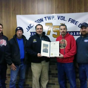 Rep. Frank Burns present a House of Representative citation to members of the Jackson Township Volunteer Fire Company to recognize the momentous occasion of their 75th anniversary.  These volunteers fulfill a vital role in their community and I can't thank them enough.