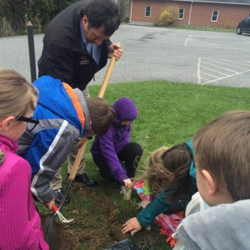 Rep. Frank Burns joined some students from Cambria County Christian School to plant a tree. As part of the project, they each received a seedling and a book about Pennsylvania trees
