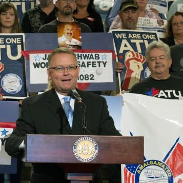 Rallying support for his legislation that would provide on-the-job safety protections to public employees, Erie state Rep. Pat Harkins speaks at a news conference on the Jake Schwab Worker's Safety Bill.