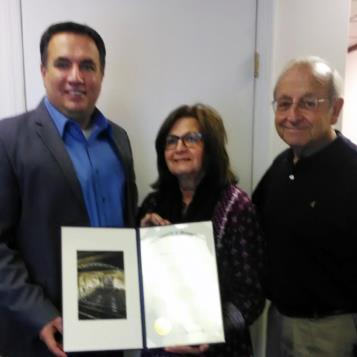 Rep. Frank Burns presents a House Citation to Mr. and Mrs. Tiracave to recognize their 50th wedding anniversary.
