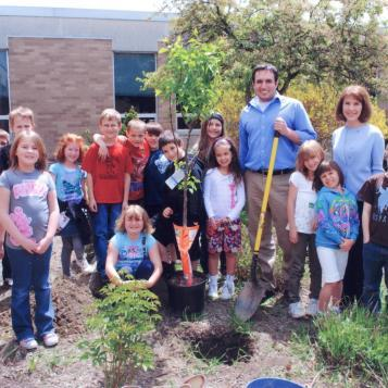 Rep. Burns helps Cambria Elementary students plant trees in celebration of Arbor Day.