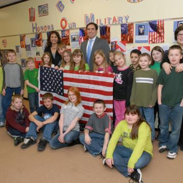 Rep. Burns participates in a flag presentation at Blacklick Valley Elementary Center. The flag pictured was flown in Afghanistan by Dr. Brian Fenchak, a member of the 492 U.S. Army Civil Affairs Battalion.
