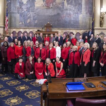 Members of the PA House of Representatives pose together to raise awareness to the number one health threat for American women - heart disease.  Every year the first Friday of February has been dedicated to National Wear Red Day.