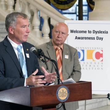 Rep. Ed Neilson speaks at a press conference in the Main Rotunda of the State Capitol to highlight October as Dyslexia Awareness Month as Senator Mario Scavello looks on.