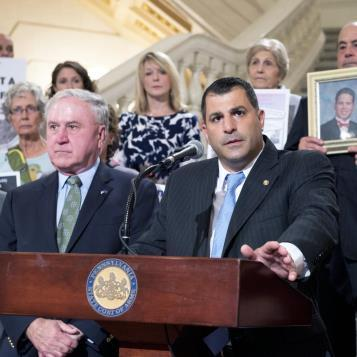 Rep. Mark Rozzi stands with advocates, survivors and other members of the General Assembly at a news conference to call on Republican House leadership to run a statute of limitations reform bill that was significantly weakened by the Senate in June through the removal of a retroactive provision that would have permitted some victims to file civil actions against their abusers that otherwise would have been barred by the statute of limitations.