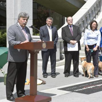 Rep. Dom Costa speaks at a Harrisburg rally calling for stricter legislation to protect pets that are left alone in hot vehicles.