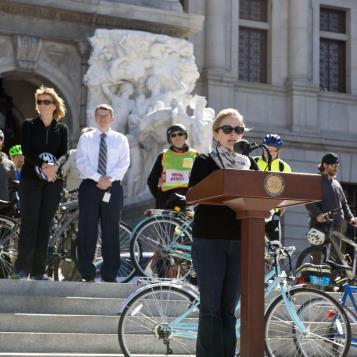 Rep. Madeleine Dean speaks at a press event to discuss 'Bike to Work Day,' encouraging others to consider biking to work, which would reduce pollution and traffic congestion, while getting exercise.