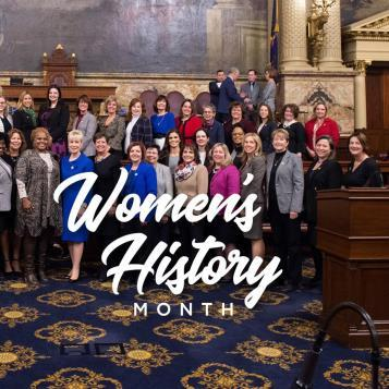 The elected females of the House of Representatives gather together to celebrate and recognize March as Women's History Month.