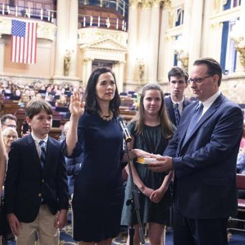 Standing before family and friends in the state Capitol, Rep. Bridget M. Kosierowski takes the oath of office to become the newest member of the Pennsylvania House of Representatives.