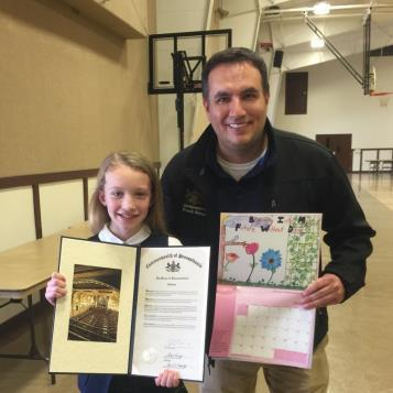 Rep. Frank Burns recently presented a citation to Abby Lee of Ebensburg, a fifth-grade student at Saint Michael School, recognizing her artistic ability in having her submission selected for inclusion in the PA State Attorney General Office's 2017 Drug-Free Calendar.